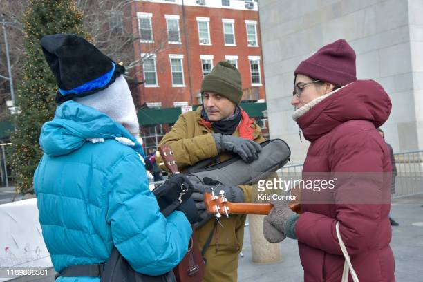 Musicians perform during Ukulele Caroling as part of Make Music Winter in Washington Square Park on December 21 2019 in New York City