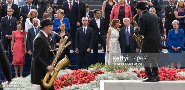 Musicians perform in front of French President Emmanuel Macron Amelie Derbaudrenghien partner of Belgian Prime Minister wife of French President...