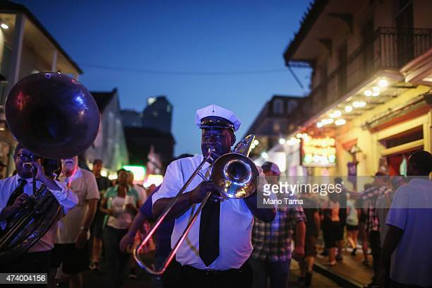NEW ORLEANS LA MAY 9 Musicians perform in the French Quarter on May 9 2015 in New Orleans Louisiana The tenth anniversary of Hurricane Katrina which...