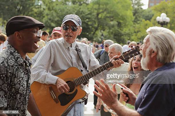 musicians perform in washington square park nyc - acoustic music stock pictures, royalty-free photos & images