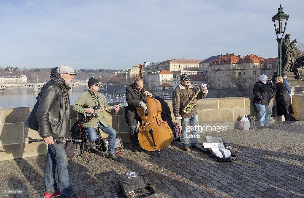 Musicians perform live on Charles Bridge in Prague, Czech Republic : Stock Photo