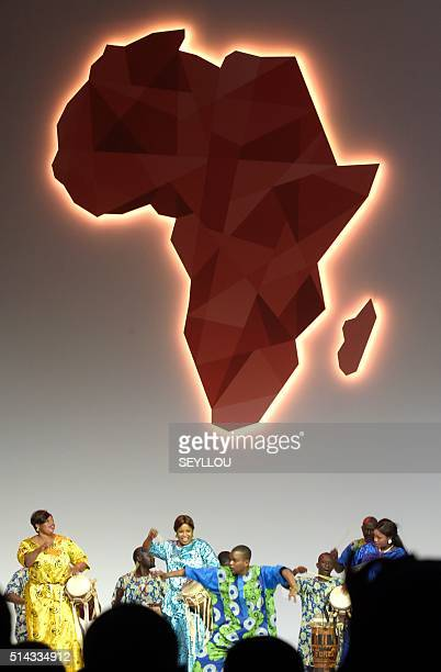 Musicians perform under an Africa's map on March 8 2016 in Dakar during the opening of the 'Next Einstein Forum' Africa's top scientists policymakers...
