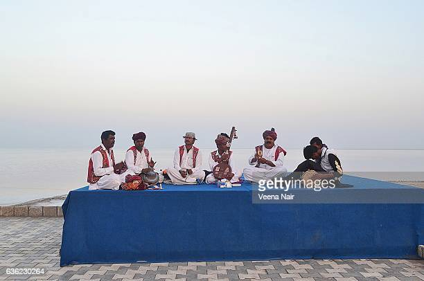 Musicians performing at the Great Rann of Kutch with salt marsh at the backdrop,Gujarat