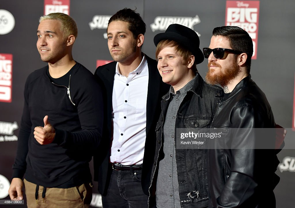 Musicians Pete Wentz, Joe Trohman, Patrick Stump and Andy Hurley of Fall Out Boy attend the premiere of Disney's 'Big Hero 6' at the El Capitan Theatre on November 4, 2014 in Hollywood, California.
