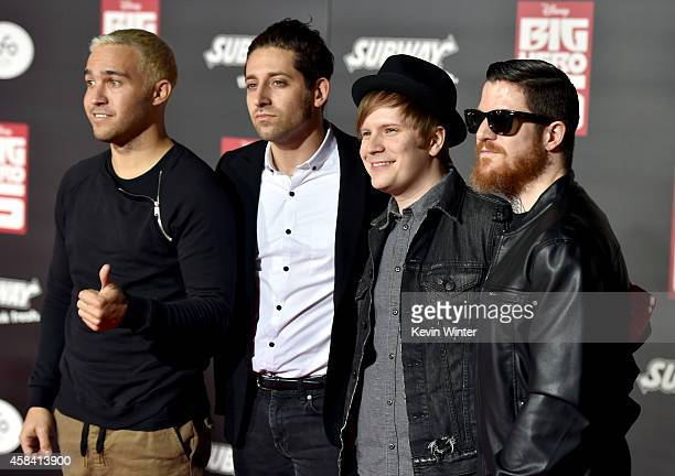 Musicians Pete Wentz Joe Trohman Patrick Stump and Andy Hurley of Fall Out Boy attend the premiere of Disney's 'Big Hero 6' at the El Capitan Theatre...