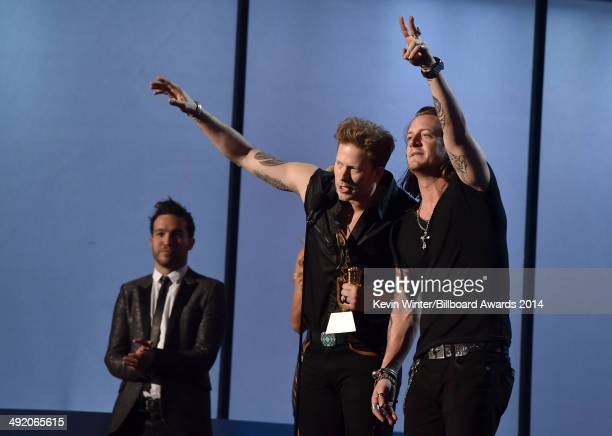 Musicians Pete Wentz of Fall Out Boy Brian Kelley and Tyler Hubbard of Florida Georgia Line speak onstage during the 2014 Billboard Music Awards at...