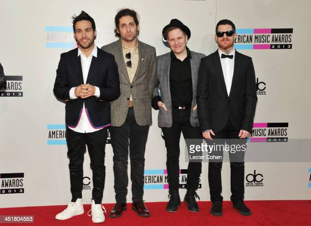 Musicians Peter Wentz Joe Trohman Patrick Stump and Andy Hurley of Fall Out Boy attends the 2013 American Music Awards at Nokia Theatre LA Live on...
