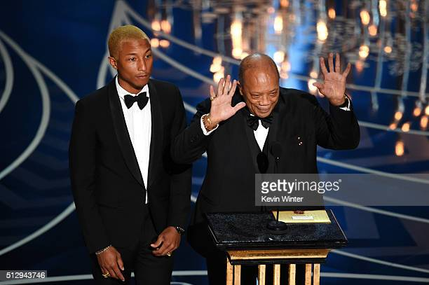 Musicians Pharrell Williams and Quincy Jones speak onstage during the 88th Annual Academy Awards at the Dolby Theatre on February 28 2016 in...
