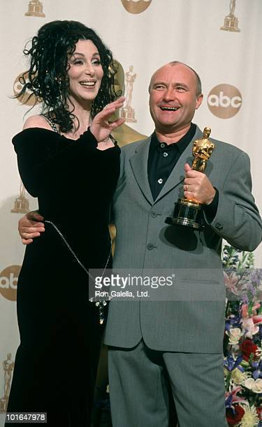 Musicians Phil Collins and Cher attending 72nd Annual Academy Awards on March 26 2000 at Shrine Auditorium in Los Angeles California