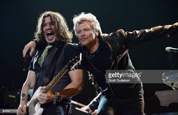 Musicians Phil X and Jon Bon Jovi of the band Bon Jovi perform onstage at The Forum on March 8 2017 in Inglewood California