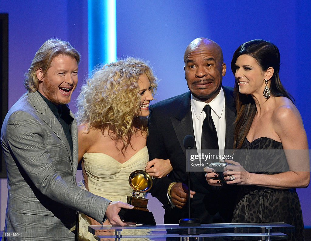 Musicians Phillip Sweet, Kimberly Schlapman and Karen Fairchild of Little Big Town, with host David Alan Grier (2nd R), accept Best Country Duo/Group Performance for 'Pontoon' onstage at the The 55th Annual GRAMMY Awards at Nokia Theatre on February 10, 2013 in Los Angeles, California.