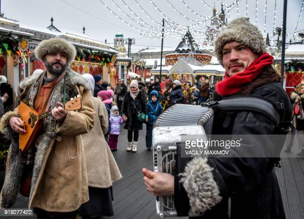 Musicians play an accordeon and a balalaika during Shrovetide celebrations in central Moscow on February 17 2018 Shrovetide is an ancient farewell...