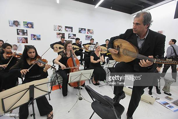 Musicians play at the opening exhibition of photographer Danny Goldfield's 'NYChildren' project at the grand opening of the Park51 community center...