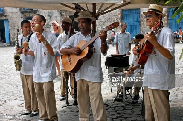 Musicians Play Cuban Rhythms on the Streets of Havana Music Old Habana Cuba Music band playing outside a restaurant Havana Cuba Caribbean