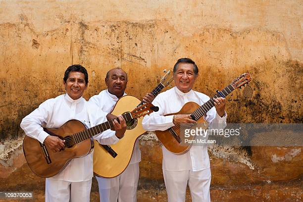 musicians (trovadores) play guitars in mexico. - merida mexico stock photos and pictures