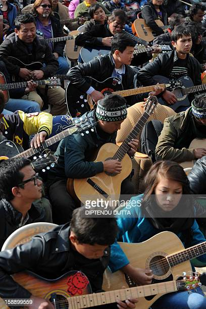 Musicians play John Lennon's Imagine in a memorial tribute to the 23year old Indian gang rape victim during a mass guitar ensemble played by some 600...