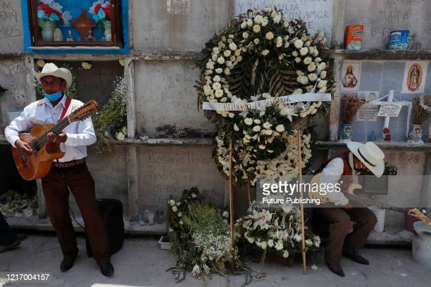 Musicians play songs to persos who died from Coronavirus during the funerals before burying their in a niche of Nezahualcoyotl cemetery on June 2...