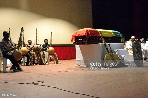 Musicians play the a 21string kora Mandingo style plucked string instrument during the funeral of Ibrahima Kouyate also known M'Bady Kouyate on...
