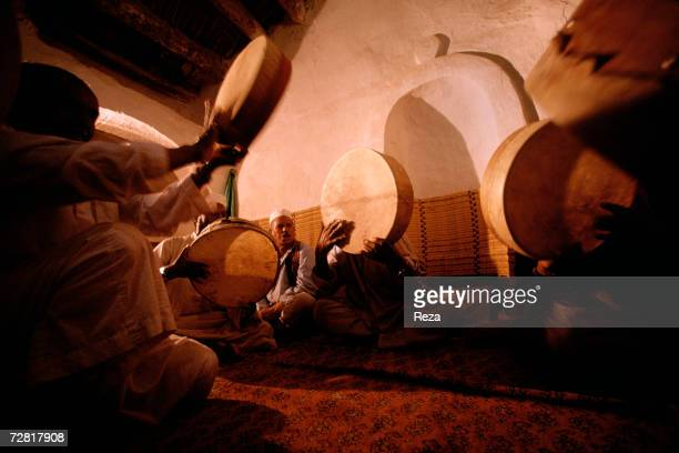 Musicians play the drums and chant at a mosque during a Sufi ceremony April, 2000 in Ghadames, Libya.