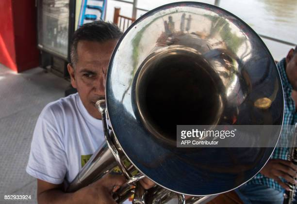 Musicians play their instruments during a river tour in Santa Cruz de Mompox a town on the banks of the Magdalena River in the northern Colombian...