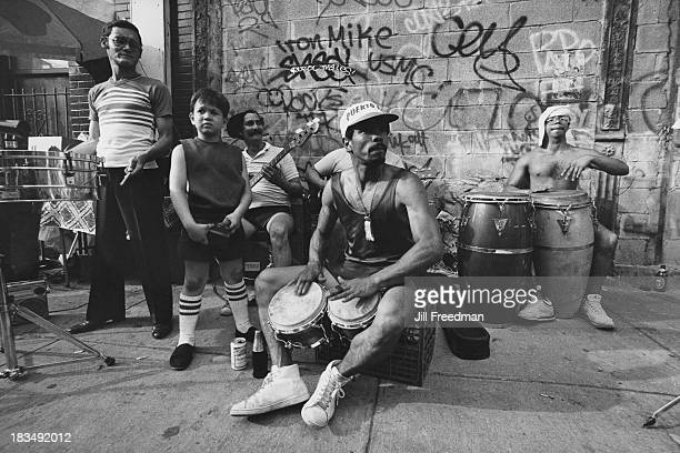 Musicians play their instruments on a New York City street circa 1982