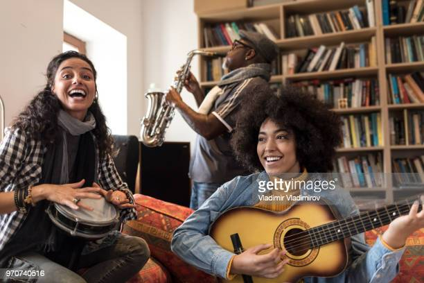 Musicians playing and singing at home
