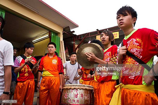 Musicians playing drum and gong accompanying the lion dance during the annual Nine Emperor Gods Festival at Kau Ong Yah Temple, Ampang, Kuala Lumpur,...