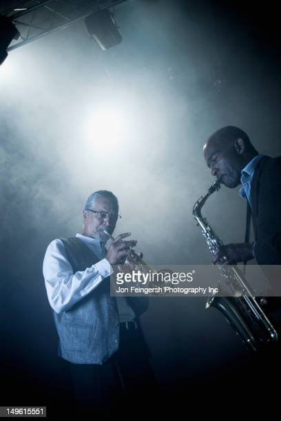 musicians playing in jazz band on stage - duet stock pictures, royalty-free photos & images