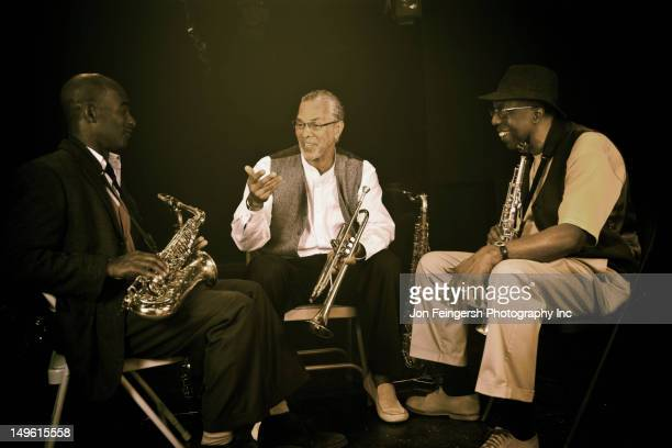 musicians playing in jazz band on stage - rockville maryland stock pictures, royalty-free photos & images