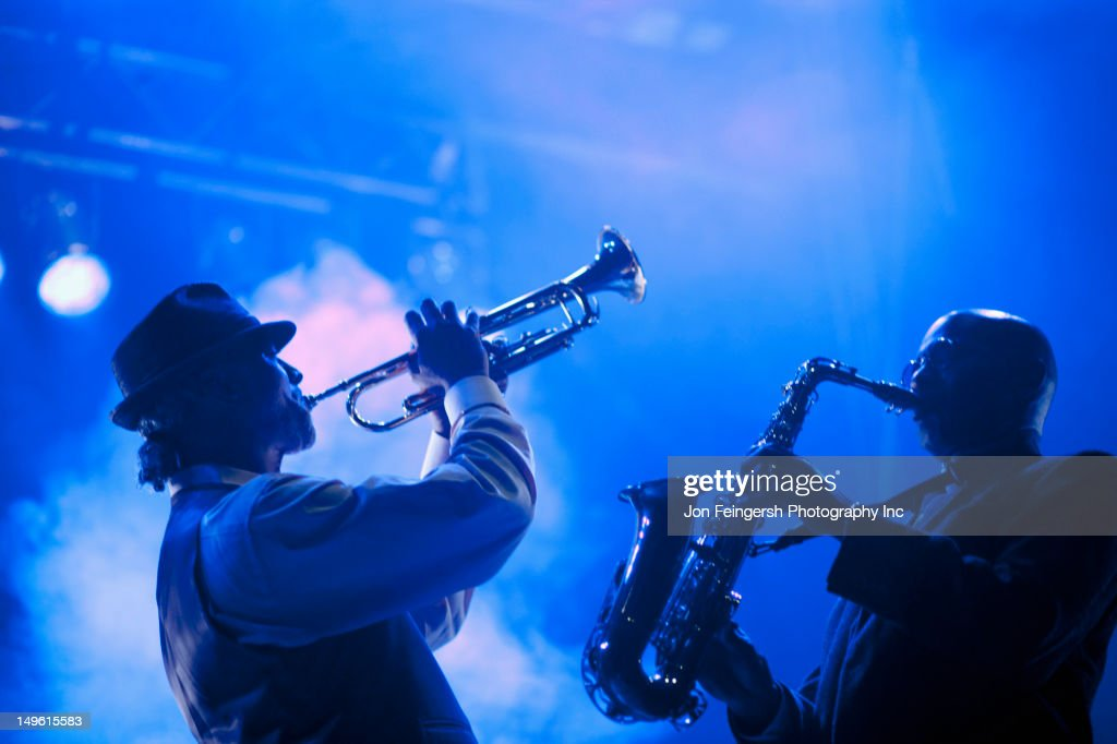 Musicians playing in jazz band on stage : Stock Photo