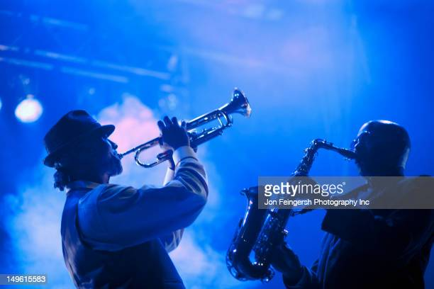 musicians playing in jazz band on stage - jazz stock pictures, royalty-free photos & images