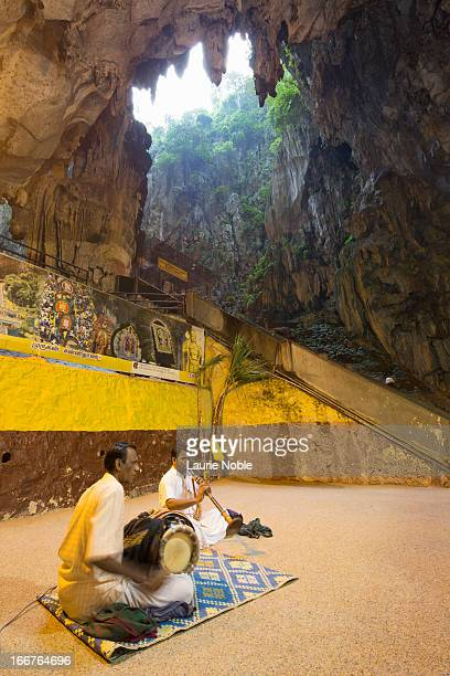 Musicians playing in Temple Cave, Batu Caves