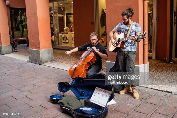 musicians playing in the streets of bologna, italy. - street artist stock pictures, royalty-free photos & images
