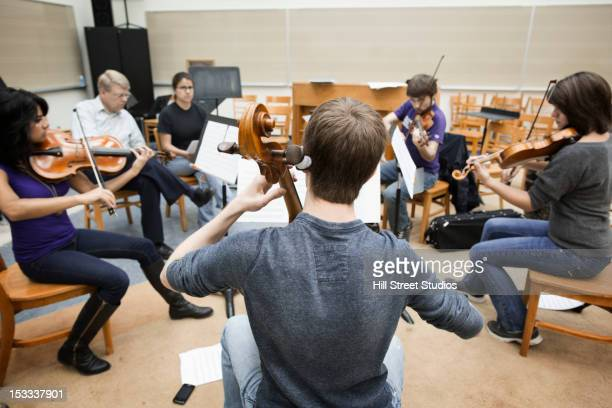 Musicians playing together in classroom