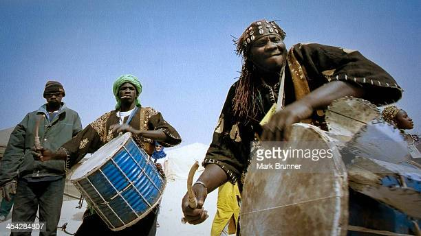 Musicians playing traditional instruments at the festival au desert music festival held near Timbuctou, mali in west africa in 2007