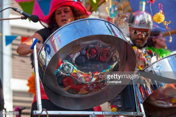 musicians playing with steel drums - steel drum stock photos and pictures