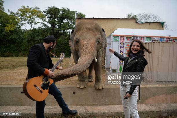 Musicians pose with Kavaan, Pakistan's only Asian elephant, during his farewell ceremonybefore travelling to a sanctuary in Cambodia later this...