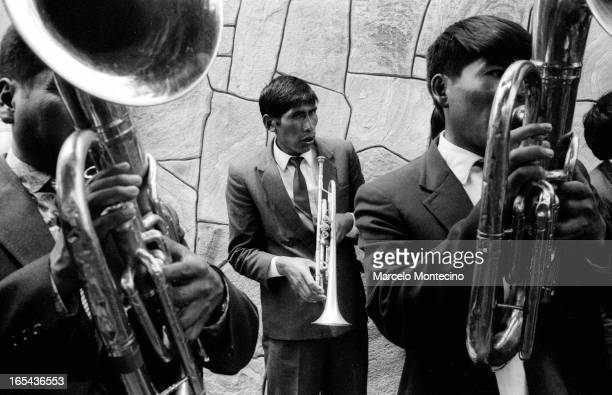 CONTENT] Musicians practice before joining parade in Oruro Bolivia