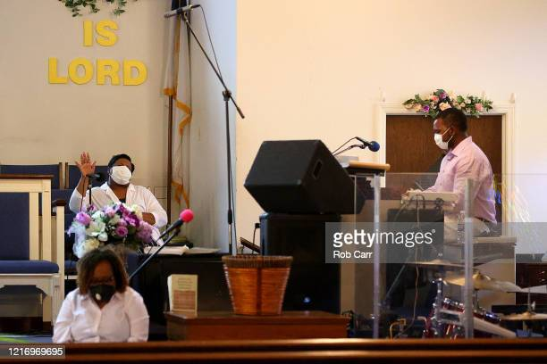 Musicians preform during a walk thru Palm Sunday Service at Friendship Baptist Church held due to the COVID19 pandemic on April 05 2020 in Baltimore...