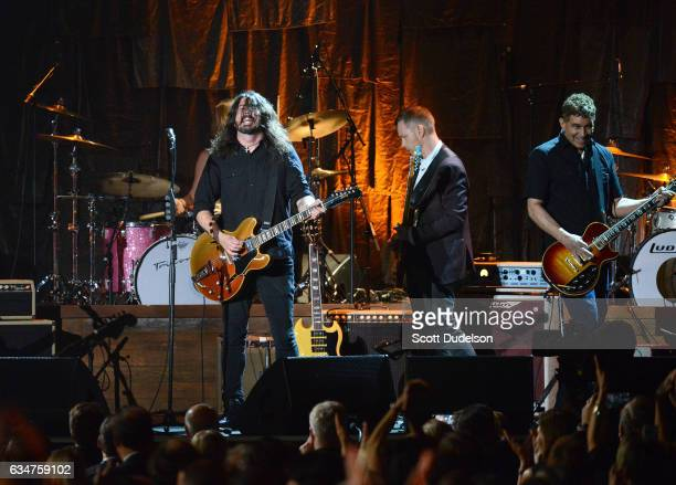 Musicians Rami Jaffee Chris Shiflett Dave Grohl and Taylor Hawkins of The Foo Fighters perform onstage during the 2017 MusiCares Person of the Year...