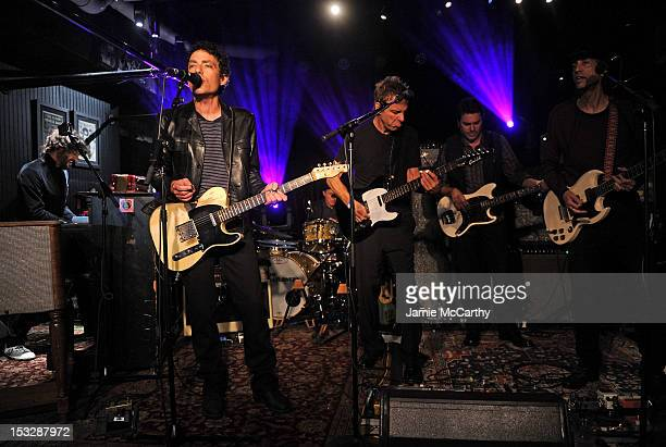 Musicians Rami Jaffee Jakob Dylan Jack Irons Jay Joyce Greg Richling and Stuart Mathis of The Wallflowers perform onstage at The Wallflowers...