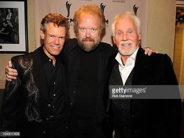 Musicians Randy Travis, Don Schlitz and Kenny Rogers pose backstage during the 4th Annual ACM Honors at the Ryman Auditorium on September 20, 2010 in...