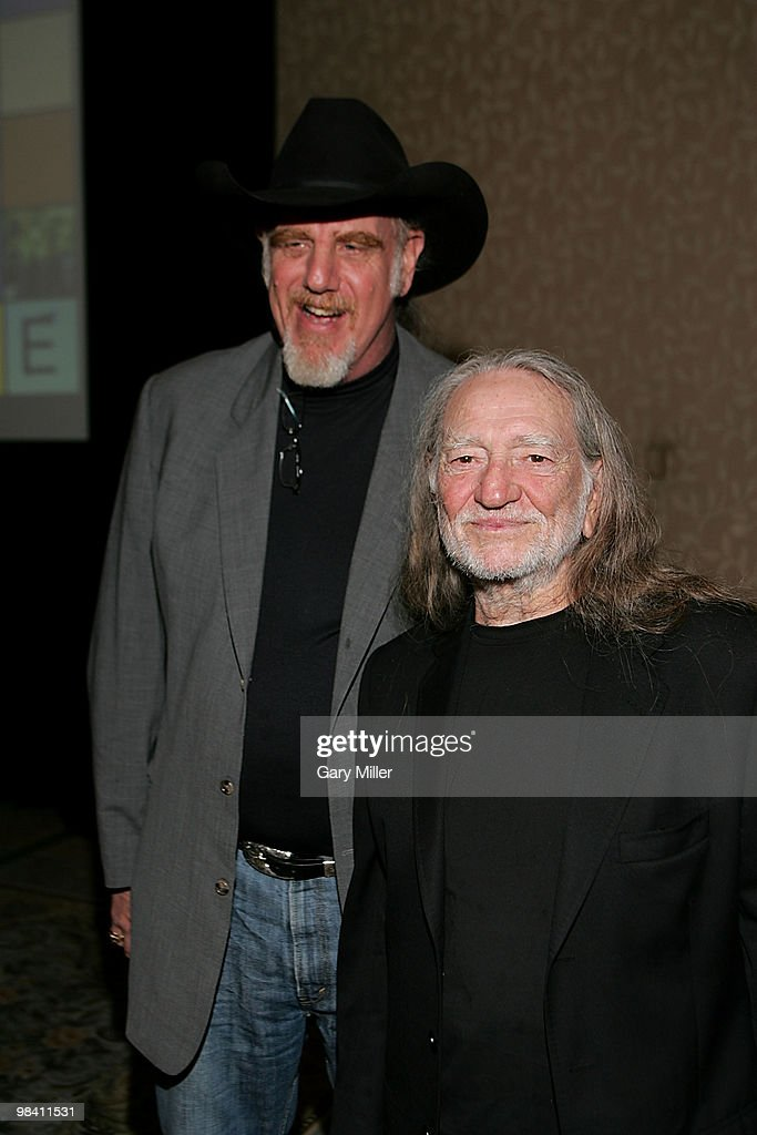 Musicians Ray Benson (L) and Willie Nelson pose on the red carpet for the Nobelity Project's dinner honoring country music legend Willie Nelson with the 'Feed The Peace' award at the Four Seasons Hotel on April 11, 2010 in Austin, Texas.