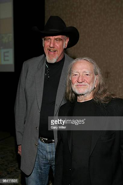 Musicians Ray Benson and Willie Nelson pose on the red carpet for the Nobelity Project's dinner honoring country music legend Willie Nelson with the...