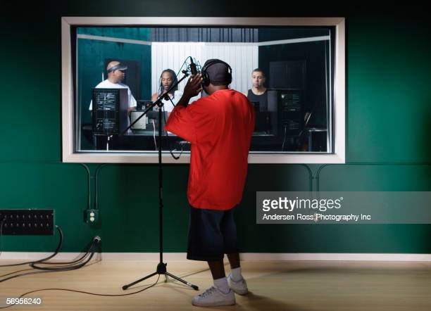 musicians recording music - recording studio stock pictures, royalty-free photos & images