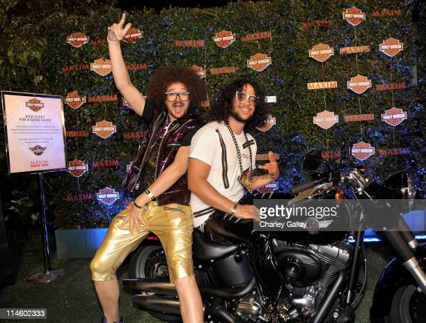 Musicians Red Foo and SkyBlu of LMFAO turn the key on a HarleyDavidson to raise money for Harley's Heroes at the 2010 Maxim Hot 100 Party held at...