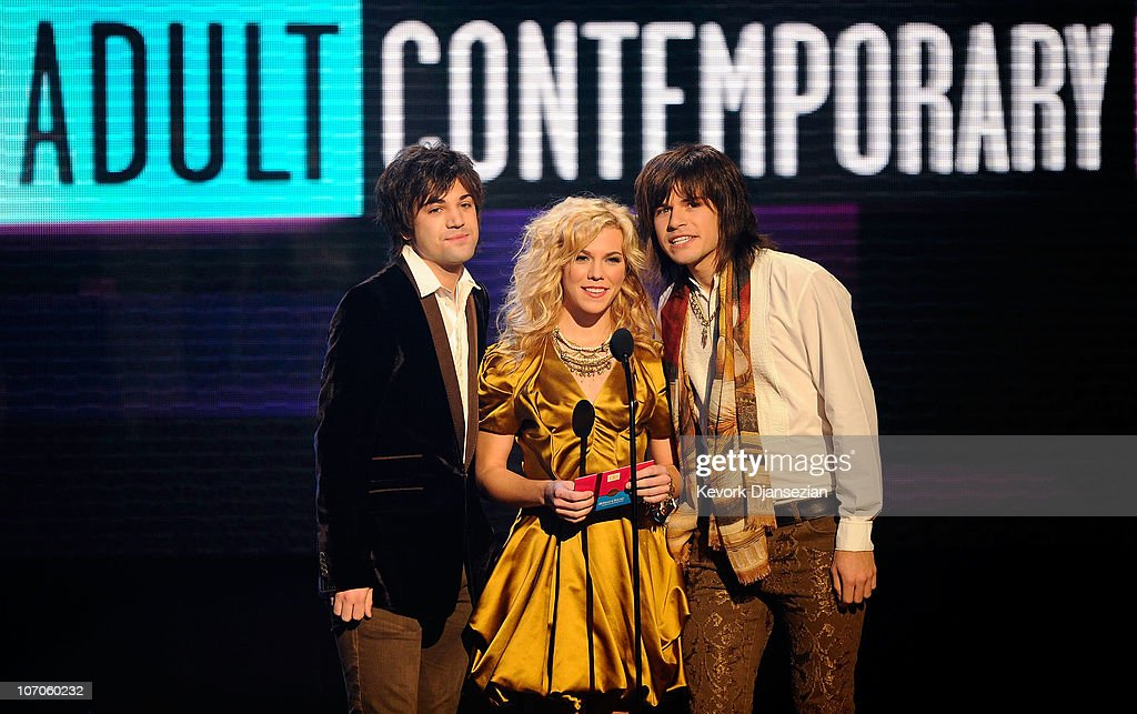 Musicians Reid Perry, Kimberly Perry and Neil Perry of The Band Perry speak onstage during the 2010 American Music Awards held at Nokia Theatre L.A. Live on November 21, 2010 in Los Angeles, California.