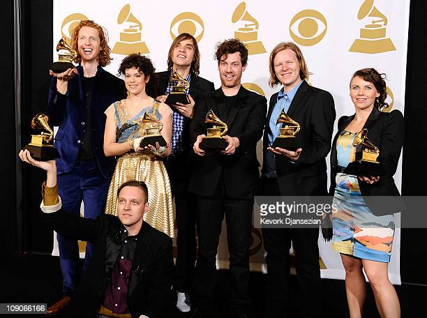 Musicians Richard Reed Parry Win Butler Regine Chassagne William Butler Jeremy Gara Tim Kingsbury and Sarah Neufeld of the band Arcade Fire winners...