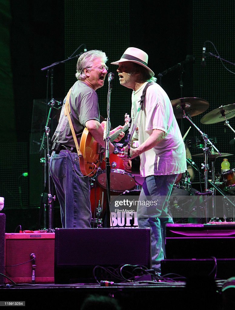 Musicians Richie Furay and Neil Young of Buffalo Springfield perform on stage during Bonnaroo 2011 at Which Stage on June 11, 2011 in Manchester, Tennessee.