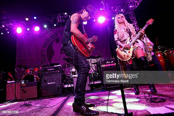 Musicians Richie Sambora and Orianthi perform on stage during the 9th Annual Medlock Krieger Celebrity Invitational And All Star Concert Benefiting...